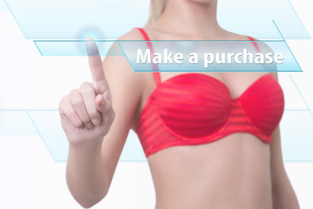 purchase: woman pressing make a purchase button