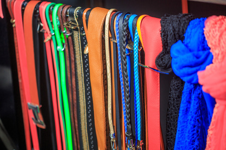 Collection of Colorful womens Belts on Rack photo