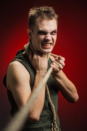 maniac: angry man with a rope around his neck