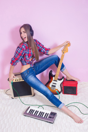 girl in headphones listens to music. electric. photo
