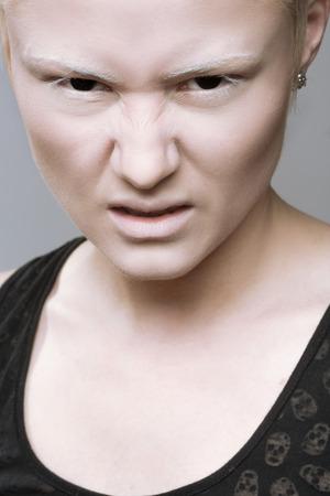 cheekbones: angry aggressive girl in black lenses. Stock Photo