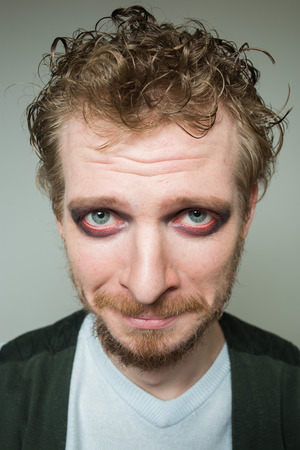 bulging eyes: prortret guilty of a bearded man with makeup.