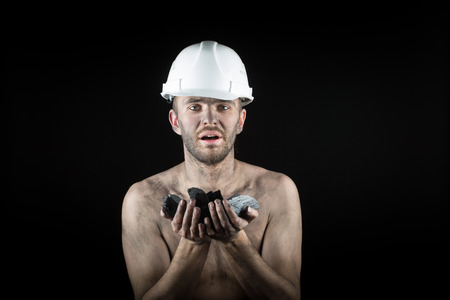 extracted: Coal miner on a black background Stock Photo