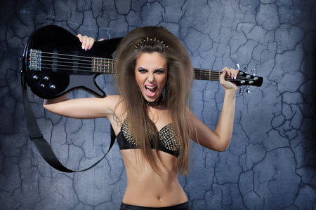 Woman playing music on a bass guitar photo