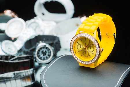 compared: Yellow watches women, compared to other hours Stock Photo