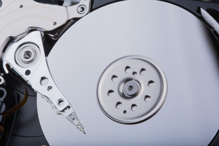 fixed disk: hard disk with moving head. Stock Photo