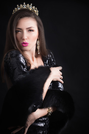 Beauty model woman wearing fur coat, diamond crown photo