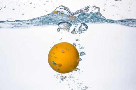 orange splash: orange splash in water Stock Photo