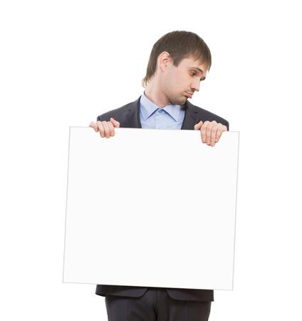 sad businessman: sad businessman holding a white blank