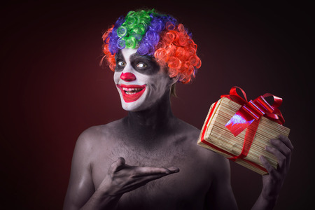 evil man: scary clown makeup and with a terrible gift