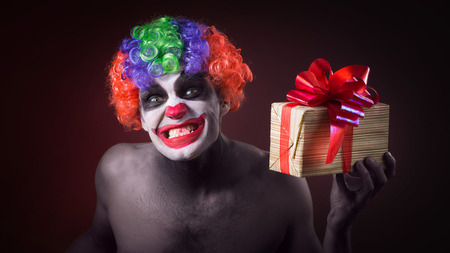 Scary Clown Makeup And With A Terrible Gift Stock Photo, Picture ...