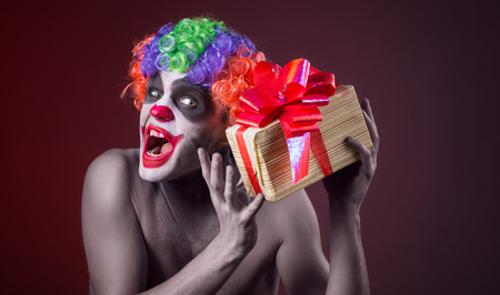scary clown: scary clown makeup and with a terrible gift