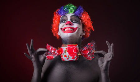 scary clown: scary clown with spooky makeup and more candy
