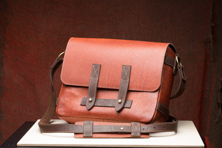Old vintage leather bag with leather strap photo