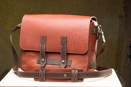 leather background: Old vintage leather bag with leather strap