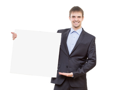 signboard: smiling business man showing blank signboard Stock Photo