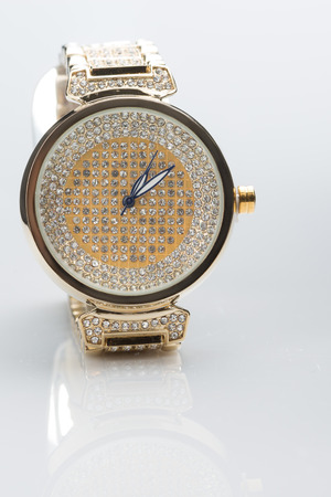 gold watch: gold watch with diamonds