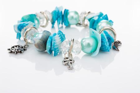 jewellery: blue bracelet with pendants