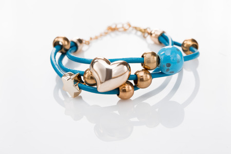 frippery: Beautiful bracelets on white background. Stock Photo