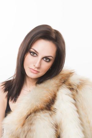 portrait of beautiful girl in furs, rings photo