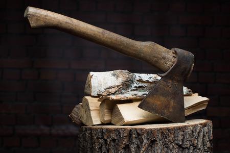 wood log: birch firewood, old rusty ax