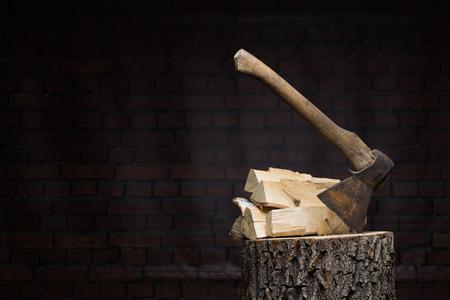 pitting: birch firewood, old rusty ax