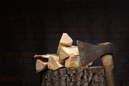 tortured: birch firewood, old rusty ax