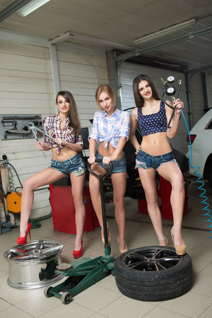 Three girls for tire. car repair