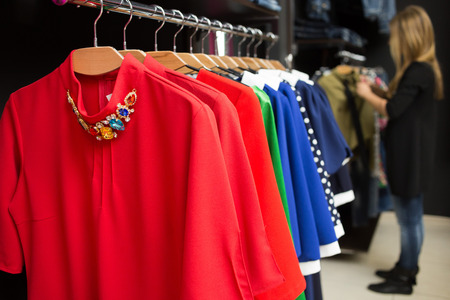 womens dresses on hangers in a retail shop photo