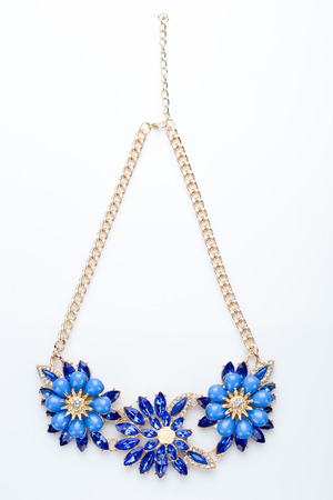 pearl necklace: plastic necklace. three blue flower