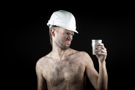 metallurgist: angry working in a dirty helmet