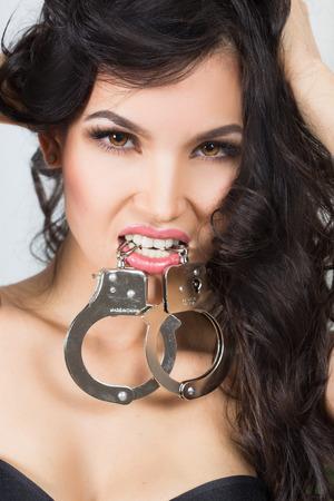 sex toy: Woman in underwear, bite handcuffs, bdsm, sex toy