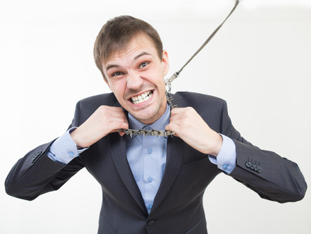 sobbing: Angry businessman on the chain with a collar.