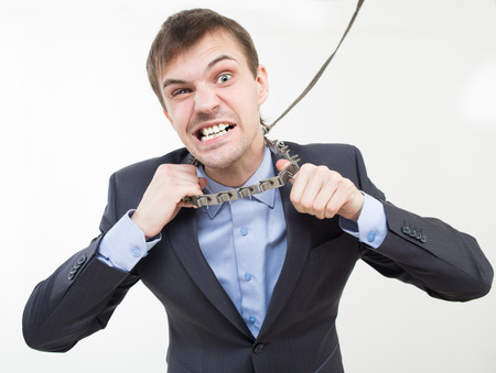 coercion: Angry businessman on the chain with a collar.