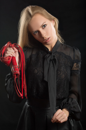 beautiful woman in biting red whip photo