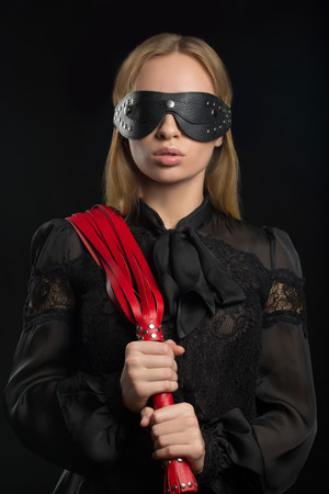 fetishism: Portrait of young beautiful woman in blindfold