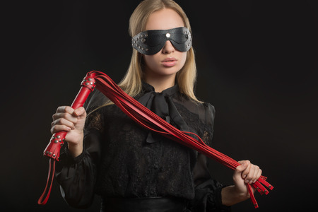 Portrait of young beautiful woman in blindfold photo