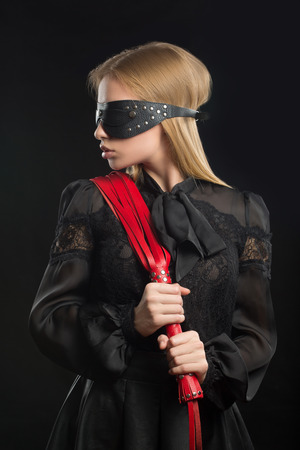 sadistic: Portrait of young beautiful woman in blindfold