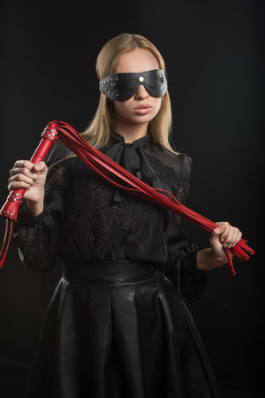 masochism: Portrait of young beautiful woman in blindfold
