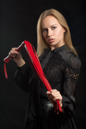 submissive: beautiful woman in biting red whip Stock Photo