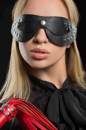 roleplaying: Portrait of young beautiful woman in blindfold