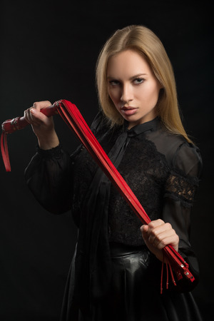 beautiful woman in biting red whip Stock Photo