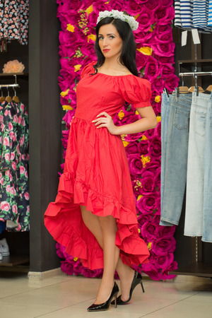 spender: the girl in a red dress in a clothing store