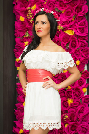 clothing store: the girl in a white dress in a clothing store Stock Photo