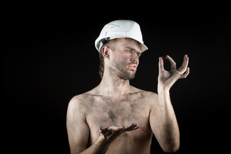 metallurgist: Happy dirty worker in helmet. gemstone, Stock Photo