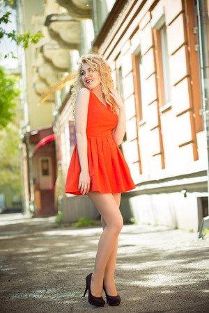 outdoor photo: outdoor photo of beautiful woman. curly white hair Stock Photo