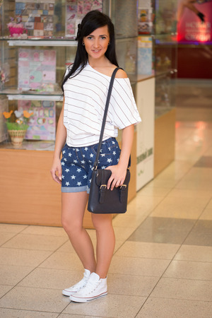 girl in short pants at the mall. Stock Photo