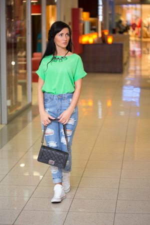 girl in jeans at the mall.