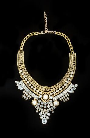 necklace: metal feminine necklace. on black  background. Stock Photo