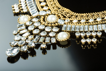 metal feminine necklace. on black  background. Foto de archivo